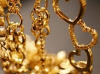 Giá vàng trượt xuống 1.370USD/ounce trước áp lực chốt lời lớn